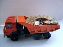 Three wheelset axled dump-truck loaded by coins. Three wheelset axled dump-truck with orange body and red cab loaded by coins Stock Images