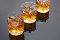 Three Whiskey Glasses on Gray Royalty Free Stock Image