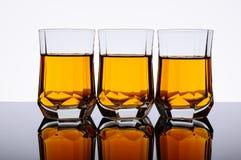 Three whisky glasses Stock Photo