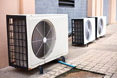 Three white air condition box. In side of building Stock Images