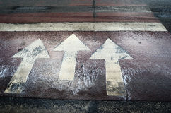 Three white arrow road markings Stock Photo