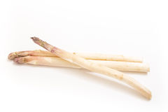 Three white asparagus spears, on white Stock Photography