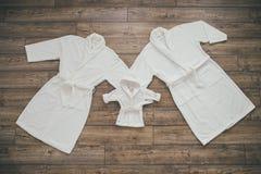 Three white Bathrobe royalty free stock photo