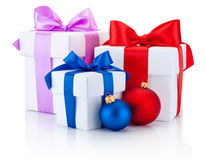 Three white boxes tied ribbon bow and christmas balls Isolated Stock Photo
