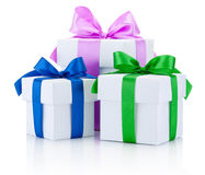 Three White boxs tied with colored satin ribbons bow Isolated Stock Photography