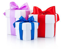 Three White boxs tied with colored satin ribbons bow Isolated Stock Photo