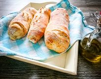 Three white bread baguett with olive oil Stock Photography