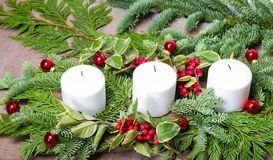 Three white candles in a centerpiece Stock Images
