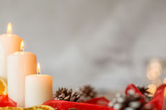 Three white candles. Three white christmas candles isolated on a light background Royalty Free Stock Image