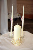 Three white candles for the wedding ceremony. The three white candles for the wedding ceremony Royalty Free Stock Photos