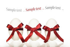 Three White Candy Easter Eggs With Red Ribbons Royalty Free Stock Photos