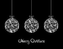 Three White Christmas balls on black background. Stock Images