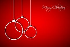 Three white christmas balls on red background, holiday card Stock Photo