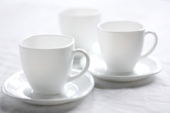 Three white cups. The Setting of the table to drinking of tea.Sound feeding Stock Photos
