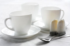 Three white cups. The Setting of the table to drinking of tea.Sound feeding Royalty Free Stock Photography