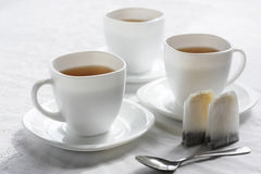 Three white cups. The Setting of the table to drinking of tea.Sound feeding Royalty Free Stock Images