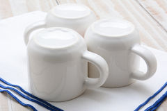 Three White Cups on Bar Towel Royalty Free Stock Photography
