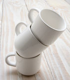 Three White Cups Stacked Royalty Free Stock Photo