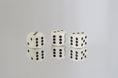Three White dice with Black spots and reflections Royalty Free Stock Photos