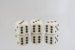 Three White dice with Black spots and reflections Stock Image