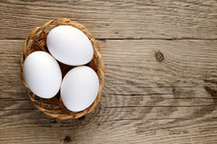 Three white eggs in basket Royalty Free Stock Photo