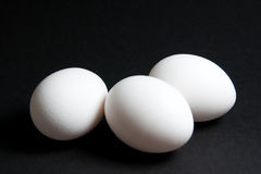 Three White Eggs on Black Background Royalty Free Stock Photo