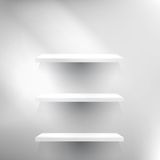 Three White empty shelves. Royalty Free Stock Photography