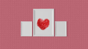 Three white frame with a red heart at centre Stock Photography