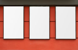 Three white frames on wall Stock Images