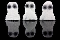 Three white ghosts on black. Three white ghosts on a black background royalty free stock photography