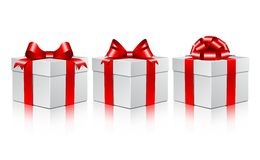 Three white gift boxes with a red bows. Vector illustration on white background Stock Photo