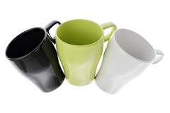 Three white green and black coffee cups in an arc Royalty Free Stock Photo