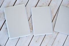 Three white mac books on the wooden floor Royalty Free Stock Images