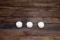 Three white marshmallows Stock Photography