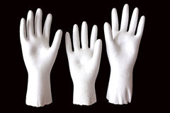 Three White Molded Raised Hands on Black Background Royalty Free Stock Image