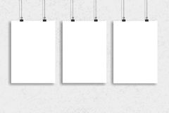 Three white paper poster mock up, Wall Mock up. Three white paper poster mock-up Stock Photo