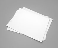 Three white paper sheets on gray Royalty Free Stock Images