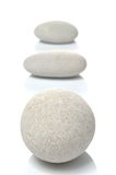 Three white pebbles Stock Photos