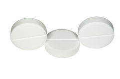 Three white pills Royalty Free Stock Photography