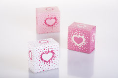 Three white and pink boxes with harts. And reflection Stock Images