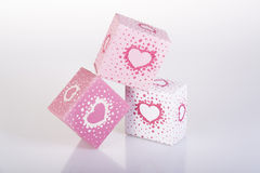 Three white and pink boxes with harts. And reflection Stock Photos