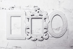 Three white plaster frames for pictures on the wall.  royalty free stock image