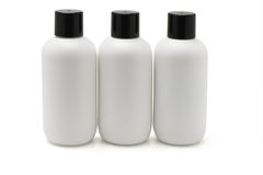 Three white plastic bottles Royalty Free Stock Photography