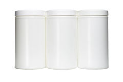 Three white plastic containers Stock Image