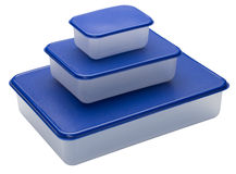 Three white plastic containers with blue caps. Royalty Free Stock Images