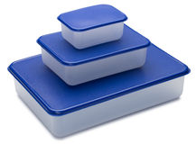 Three white plastic containers with blue caps. Stock Photos