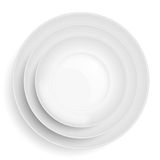 Three white plates stacked on top of each other Stock Photo