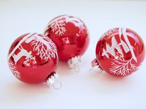 Three White-and-red Christmas Tree Printed Baubles royalty free stock image