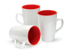 Three white and red mugs isolated on white background Stock Photo