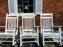 Three White Rocking Chairs Royalty Free Stock Photography